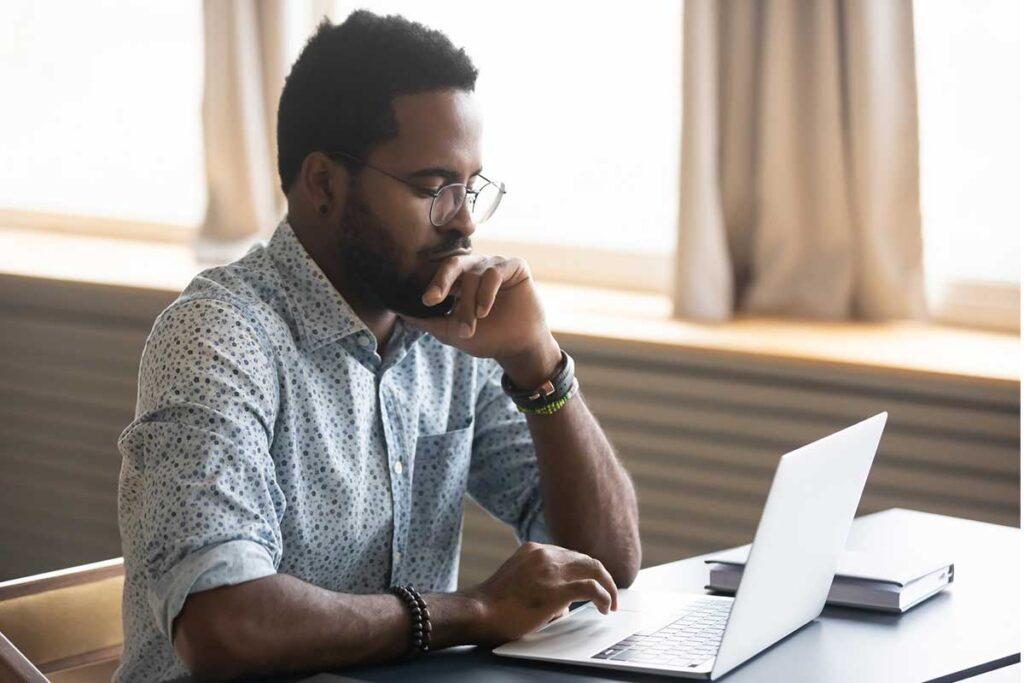 man-making-decision-on-laptop