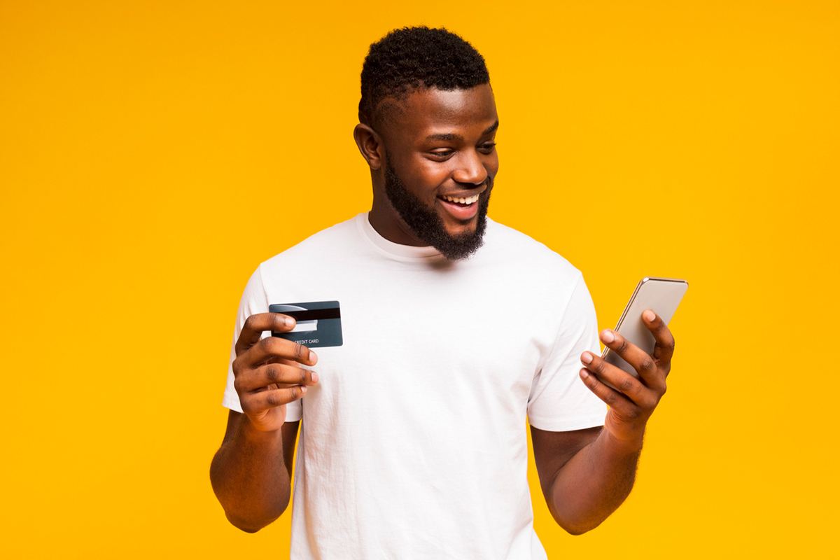 man-making-credit-card-purchase-on-phone